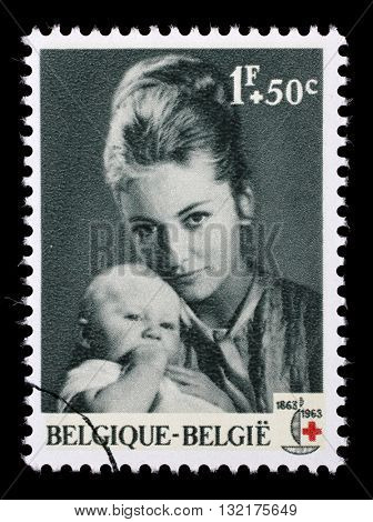 ZAGREB, CROATIA - JUNE 25: A stamp printed in Belgium shows Princess Paola with Princess Astrid is dedicated to the 100th anniversary of the Red Cross, circa 1963, on June 25, 2014, Zagreb, Croatia