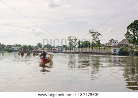Kuching Malaysia - August 9 2014: People crossing the Sarawak River on boat from the Waterfront Promenade in Kuching Borneo Malaysia.