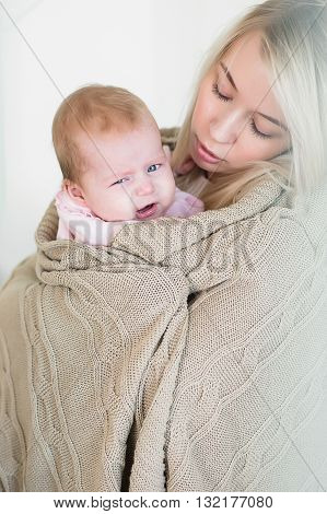 Mother Comforts, So As Not To Cry Her Infant Daughter
