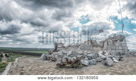 Monument to Soviet soldiers piled rubble destroyed after the hostilities of 2014. DPR Ukraine Saur-Tomb. poster