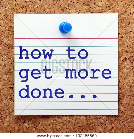 The question how to get more done in blue text on a note card pinned to a cork notice board as a reminder to find ways to increase productivity