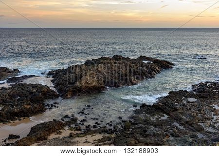 Sunset on the Bay of All Saints side of the Barra Lighthouse in Salvador