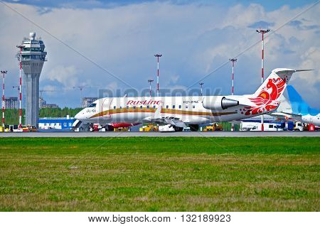 SAINT PETERSBURG RUSSIA - MAY 11 2016. VQ-BNE Rusline Airline Canadair Regional Jet CRJ-100ER airplane rides on the runway after landing in Pulkovo airport