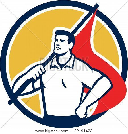 Illustration of a union worker holding red flag on shoulders with one hand on hips looking to the side set inside circle done in retro style.