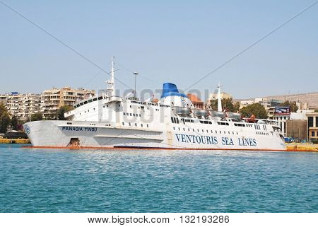 ATHENS, GREECE - MAY 13, 2016: Ventouris Sea Lines ferry Panagia Tinou listing badly in Piraeus harbour after taking on water. The boat was previously the Folkestone - Boulogne ferry Hengist.