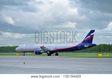 ST PETERSBURG RUSSIA - MAY 11 2016. VP-BDC Aeroflot Airbus A321 airplane is riding on the runway after arrival at Pulkovo International airport