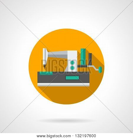 Manual sewing machine with green elements. Equipment for tailoring, dressmaking, cloth mending. Yellow round flat design vector icon with long shadow.