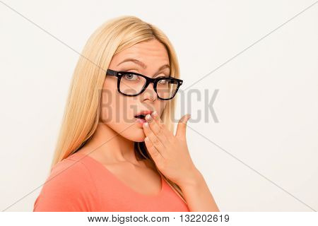 Shocked Brainy Girl In Glasses Holding Hand Near Mouth