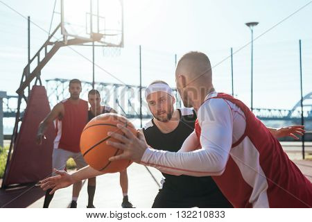 A young basketball player prepares to dribble a ball.