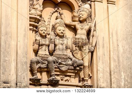 A carving of the demon-king Vibhishana being crowned as king at the Kelaniya Temple, Sri Lanka.