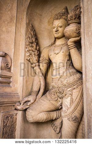 A carving of a doorkeeper at the Kelaniya temple, Sri Lanka.