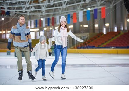 Family with child at ice-skating rink