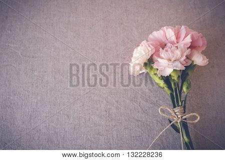 Pink carnation flowers bouquet copy space background