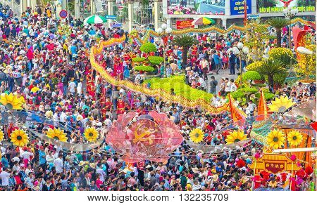 Binh Duong, Vietnam - February 22nd, 2016: Festival Chinese Lantern with colorful dragons marched in streets to show prosperity development, surrounded by crowds watching festival of ethnic in Binh Duong, Vietnam