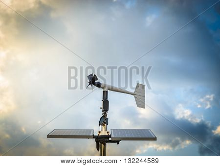 A solar powered anenometer against a dramatic stormy sky