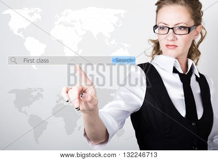 first class written in search bar on virtual screen. technology, internet and networking concept. Internet technologies in business and home. woman in business suit and tie, presses a finger on a virtual screen.