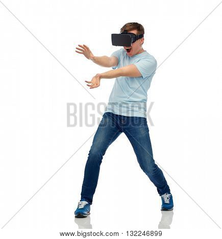 3d technology, virtual reality, entertainment, cyberspace and people concept - happy young man with virtual reality headset or 3d glasses playing game and catching something