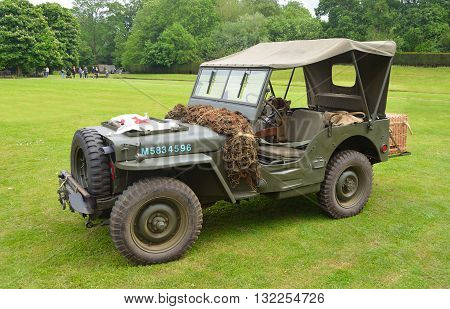 Silsoe, Bedfordshire, England - May 30, 2016: World War 2 Jeep with Red Cross Banner parked on grass..