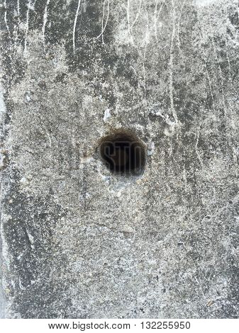 Hole on concrete electric pole background surface