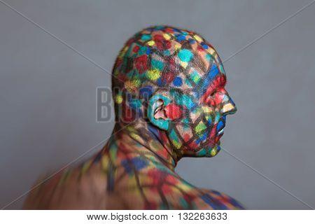 Superhero profile portrait colorful body art with tilt shift and motion blur effect.