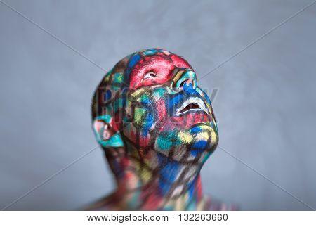 Surprised Superhero portrait colorful face art with tilt shift and motion blur effect.