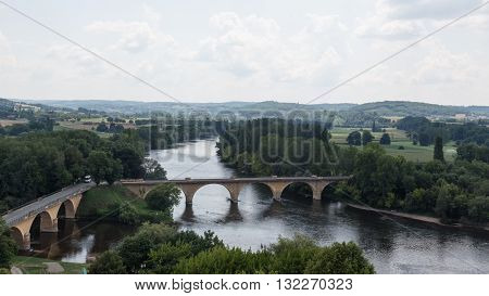 Bridges span France's Dordogne River in the Perigord
