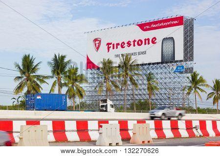 BANGKOK THAILAND - MAY 25 : advertising Firestone on billboard at blue sky background on May 25 2016 in Bangkok Thailand