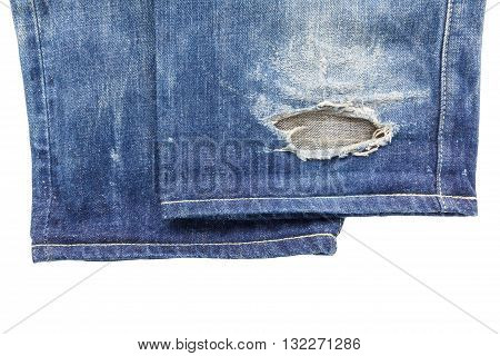 close up of cuff blue torn denim jeans isolated on white background