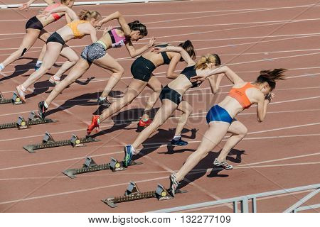 Chelyabinsk Russia - May 24 2016: group of girls athletes start to sprint 100 meters during UrFO Championship in athletics