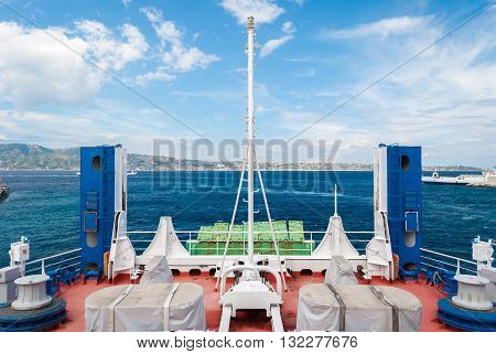 Stern of a ferry boat sailing through the strait of Messina, in Sicily