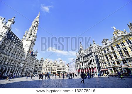 BRUSSELS BELGIUM - MARCH 16: Wide angle shot with tourists visiting the Grand Place on March 16 2016 in Brussels.