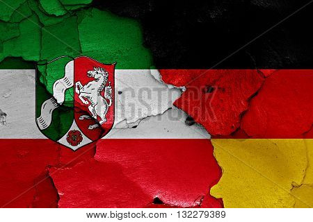 Flags Of North Rhine Westphalia And Germany Painted On Cracked Wall