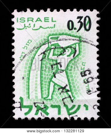 ZAGREB, CROATIA - SEPTEMBER 18: A stamp printed in the Israel, shows sign of the zodiac aquarius, - month of sabbath, circa 1961, on September 18, 2014, Zagreb, Croatia