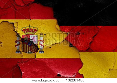 Flags Of Spain And Germany Painted On Cracked Wall