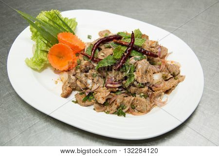 Spicy pork salad is thai food that savor sour and spicy.