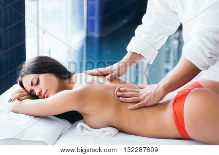 Woman And Massage Therapist