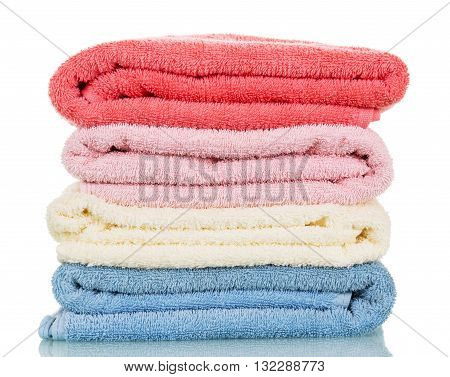 Four of terry towels of different colors isolated on white background.