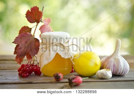 Honey and others natural medicine for winter flue on wooden table