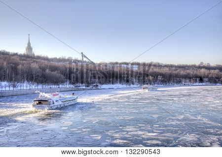 MOSCOW RUSSIA - January 29.2012: Excursion ship swims on the waterway of the river Moskva among ice