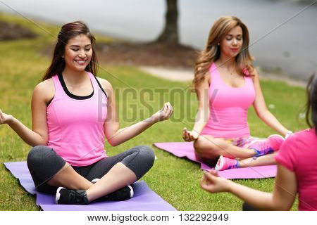 Group of women doing a group fitness workout together