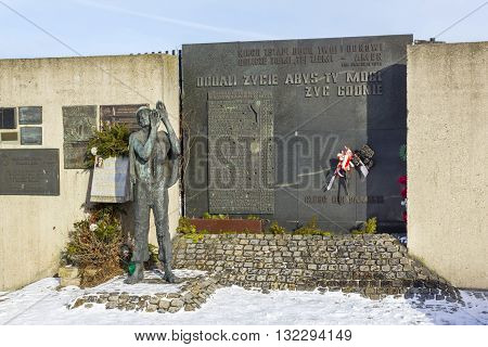 GDANSK, POLAND - JANUARY 30: Monument and a plaque next to the gate number 2 of the Gdansk Shipyard on January 30, 2011 in Gdansk.