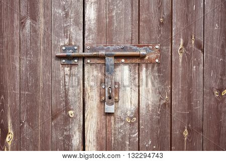 Old Metal Hasp On Old Wooden Door.
