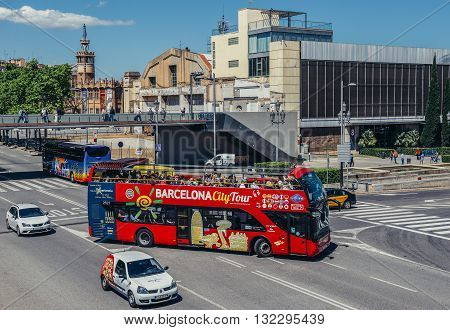 Barcelona Spain - May 22 2015: Barcelona CityTour tourist double-decker bus in front of Caixa Metallurgical place