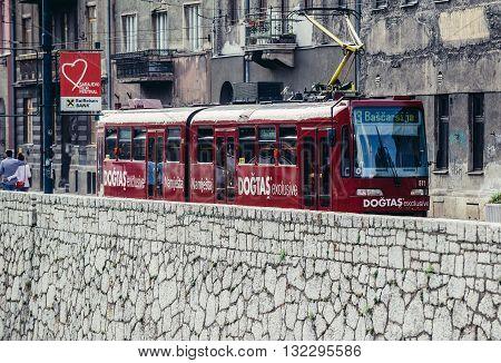 Sarajevo Bosnia and Herzegovina - August 23 2015: red tram car at Obala Kulina Bana Street in Sarajevo city