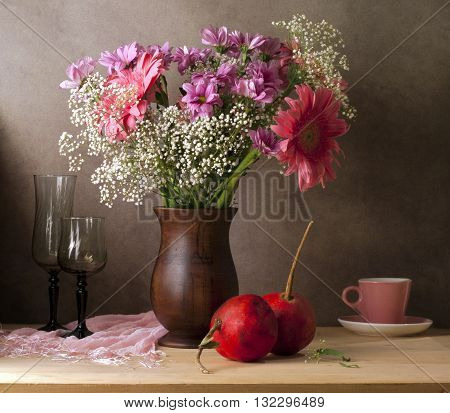 Classical still life with flowers and pomegranate