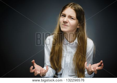 Portrait of disappointed girl isolated on gray background. Negative human emotion, facial expression. Closeup.