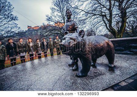 Edinburgh UK - January 20 2015. Polish scouts next stands in front of Wojtek the Soldier Bear Memorial in Edinburgh city