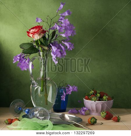 Romantic still life with flowers and strawberry
