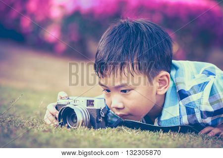 Boy Taking Photo By Camera, Exploring Nature At Park. Adorable Child In Nature, Outdoors. Vintage St