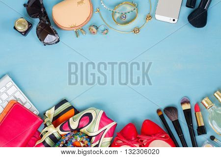 styled feminine desktop - woman fashion items on blue wooden background
